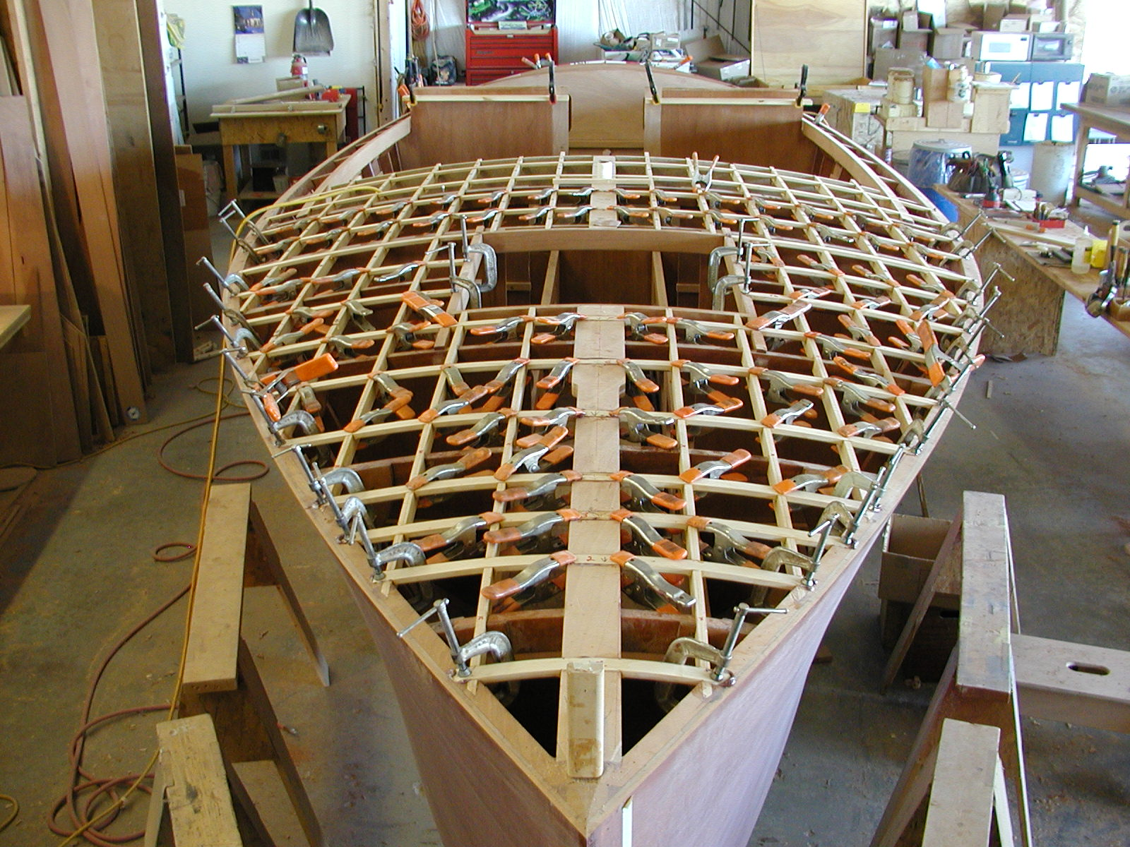 Clamps holding deck framing