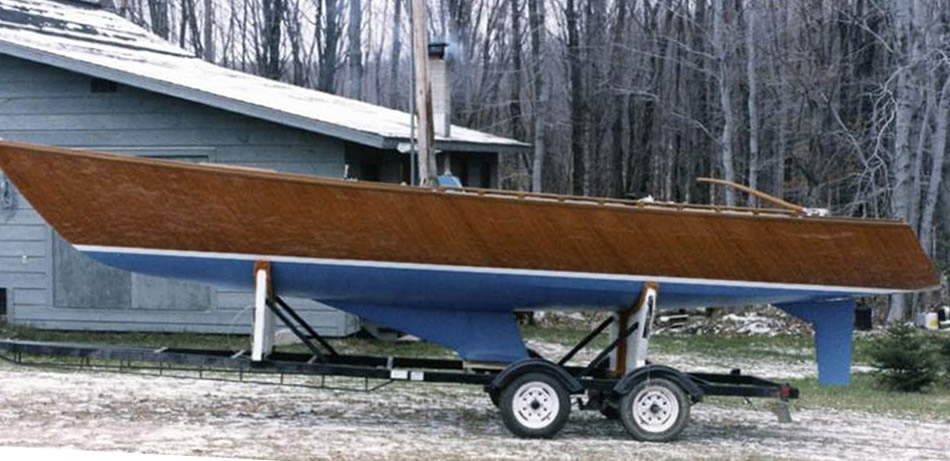 Wooden sailboat with custom trailer.