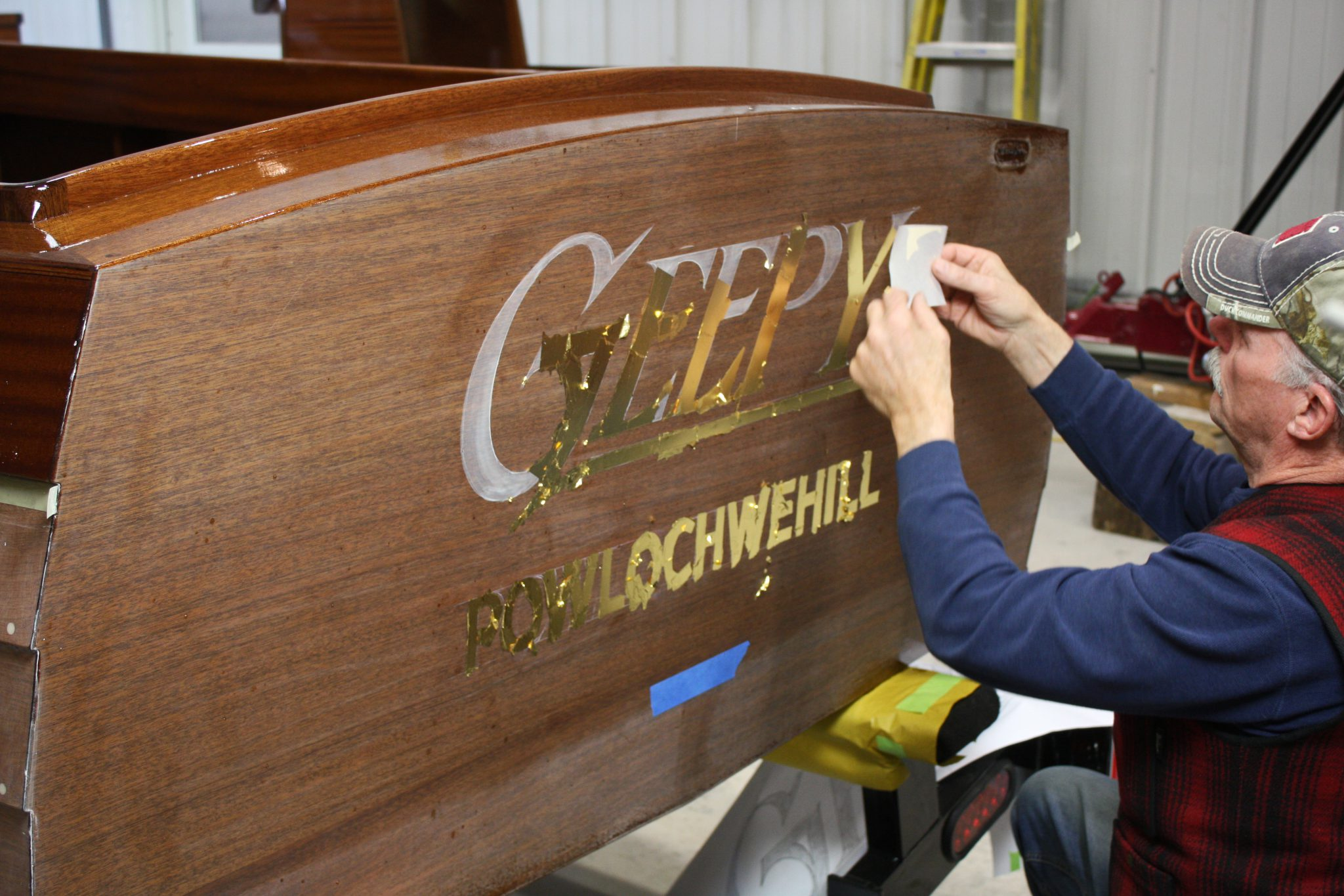 23 karat gold leaf being applied to transom of Geepy