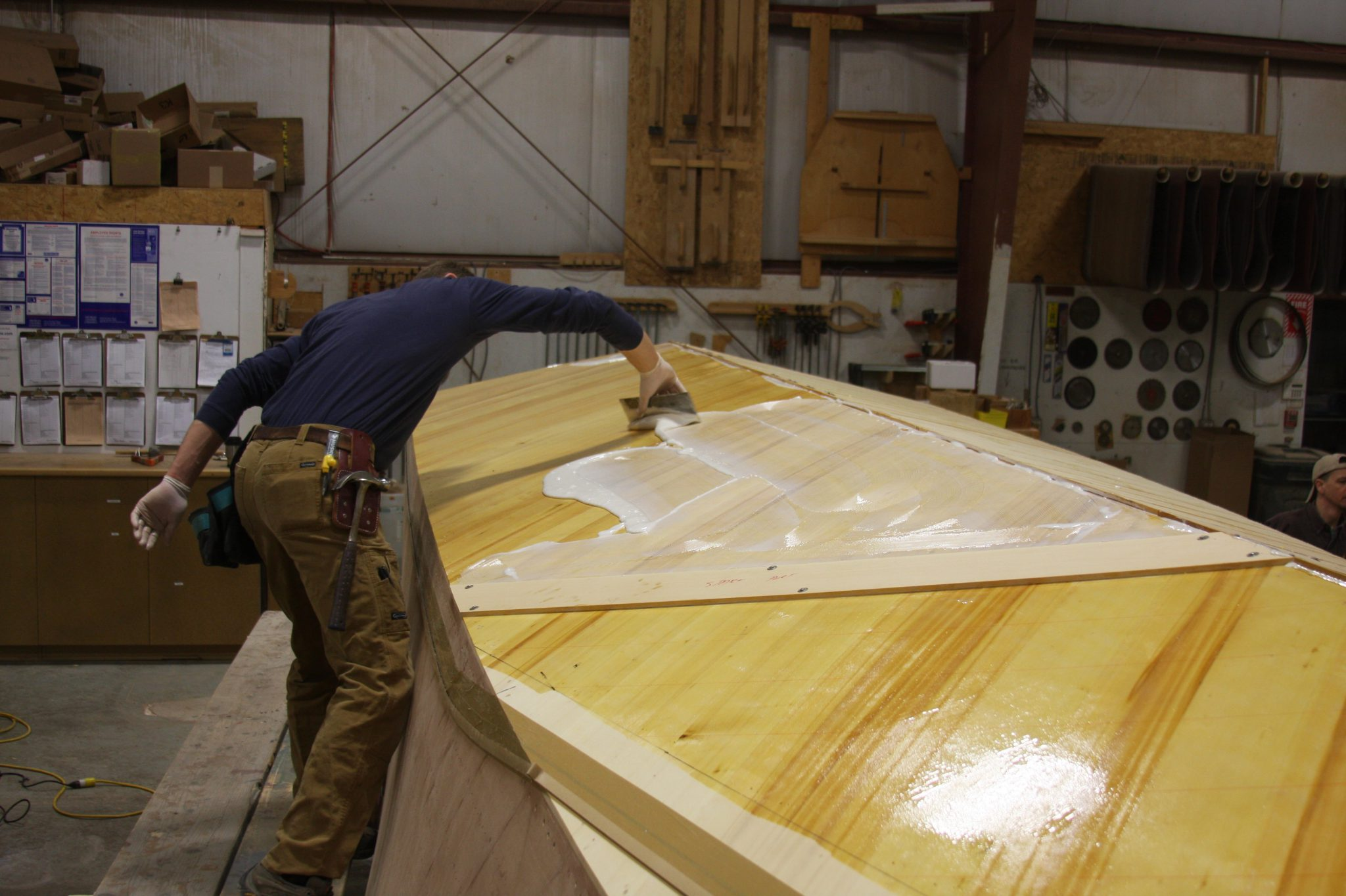 Applying epoxy to layer of planking on 3/4 Time