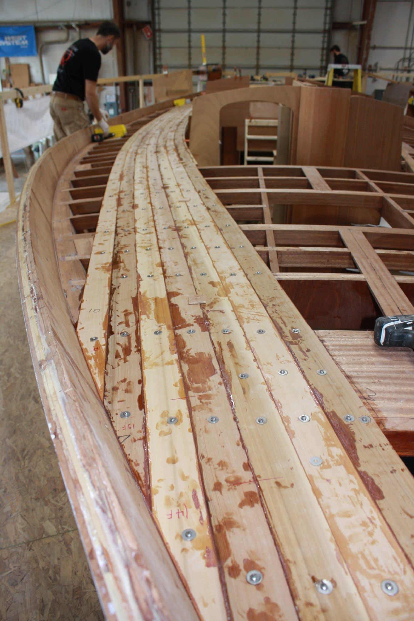 Initial deck planking being installed on Italmas