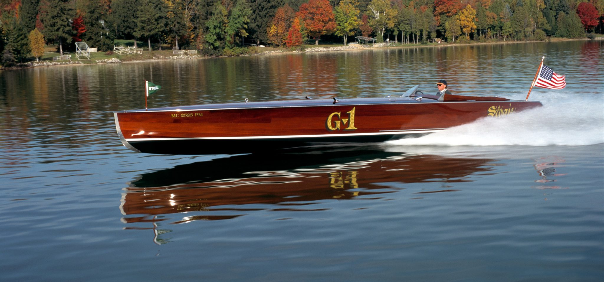 A side shot of the Stogie boat speeding through the water.