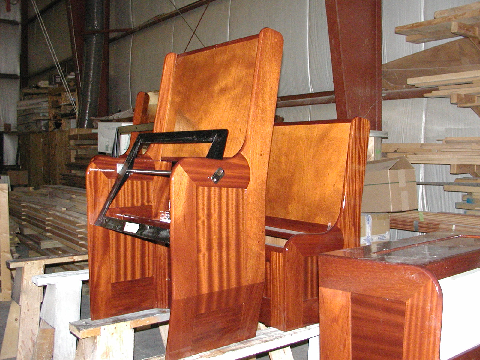 Custom mahogany woodworking on seating